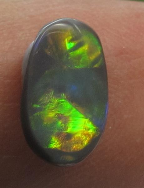 Krisnolan Australia Victoria Gemstones Opal Multi-Color Oval Cabochon Single Opaque